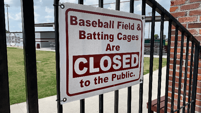 The sign at Tiger Field usually just applies to the general public but has since taken on more of a meaning as not even Breaux Bridge baseball players are allowed inside. — Photo by Raymond Partsch III