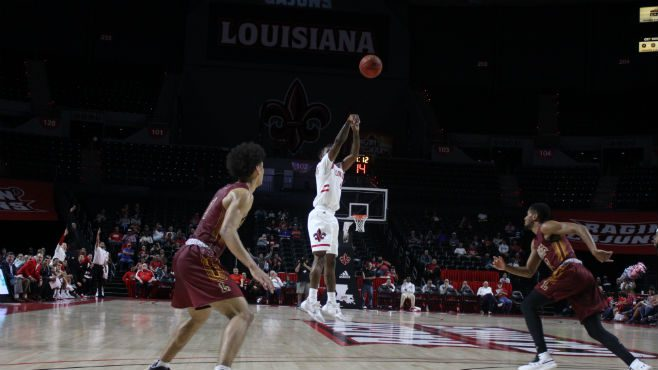 University of Louisiana guard Cedric Russell shoots the ball during Tuesday night's season opener against Loyola of New Orleans.