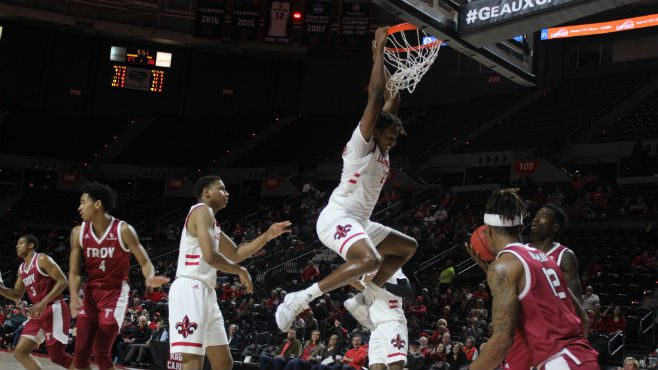Cajuns forward Tirus Smith dunks with authority in the first half against the Troy Trojans. Photo courtesy of Clint Domingue