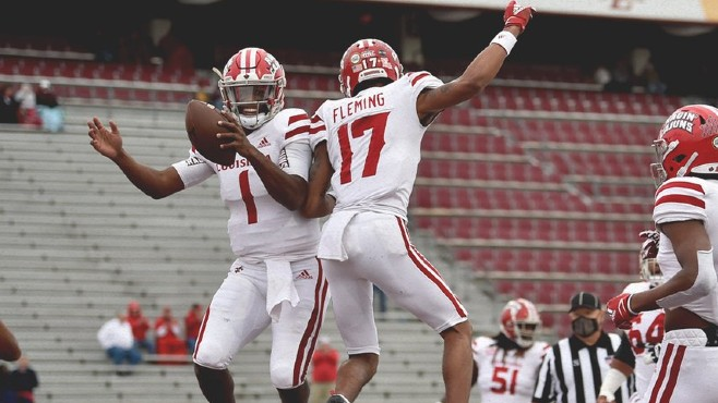 University of Louisiana quarterback Levi Lewis (No. 1) celebrates a touchdown with wide receiver Dontae Fleming (No. 17) during Saturday's win at ULM. — Photo courtesy of Ragin' Cajuns Athletics