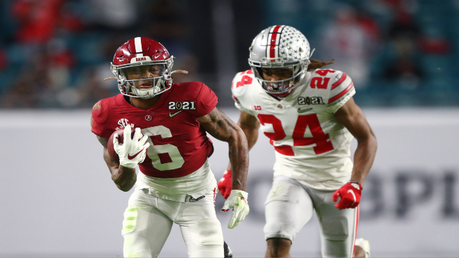 Alabama wide receiver DeVonta Smith (6) hauls in a catch against Ohio State during the 2021 College Football Playoff National Championship Game in Miami. Photo courtesy of Mark J. Rebilas-USA TODAY Sports
