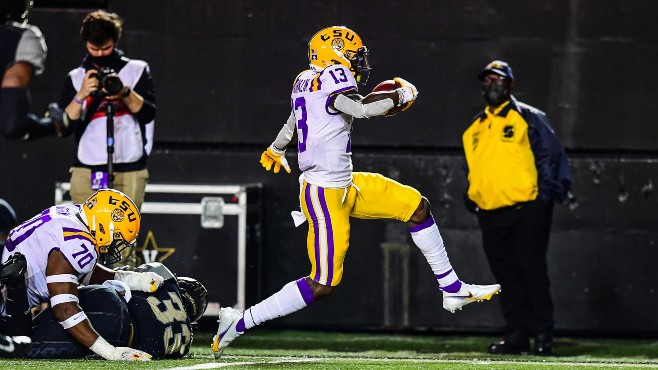 LSU's Jontre Kirklin escapes a Vanderbilt defender during Saturday's game. The Tigers won the game 41-7. — Photo courtesy of CBS Sports