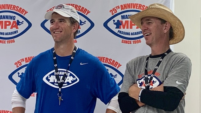 Eli and Cooper Manning share a laugh during Friday's Media Day at the Manning Passing Academy. -- Photo by Raymond Partsch III