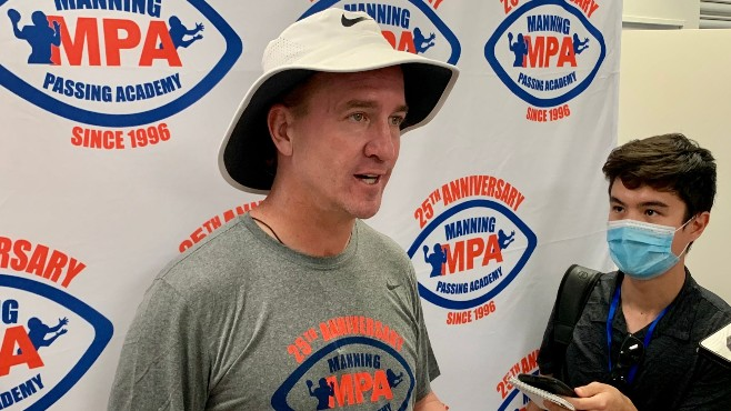 Pro Football Hall of Fame inductee and two-time Super Bowl champion Peyton Manning answers a reporter's question during Friday's Media Day at the Manning Passing Academy. -- Photo by Raymond Partsch III