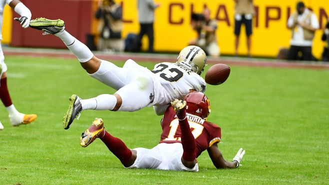 New Orleans Saints cornerback Marshon Lattimore (23) breaks up a pass intended for Washington Football Team wide receiver Terry McLaurin (17) during the second half of Sunday's game at FedExField in Landover, Maryland. Lattimore has been named NFC Defensive Player of the Week. -- Photo by Brad Mills-USA TODAY Sports