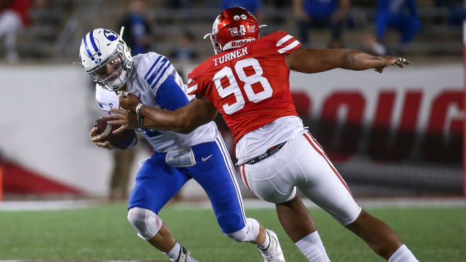 Brigham Young quarterback Zach Wilson (1) is sacked by Houston defensive lineman Payton Turner (98) during a game from last season. Photo courtesy of Troy Taormina-USA TODAY Sports