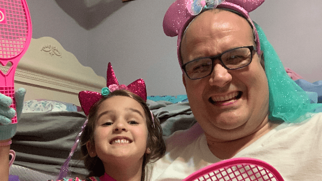 RP3 and Company co-host Raymond Partsch III and his daughter Hattie take time out to have some fun while dealing with COVID-19. Yes, those are glitter-covered Minnie Mouse ears he is wearing. — Photo courtesy of Raymond Partsch III