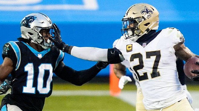 New Orleans safety Malcolm Jenkins stiffs arm a Carolina player after hauling in an interception during Sunday's 33-7 win. — Photo by CBS Sports