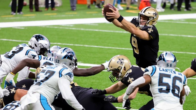 New Orleans Saints quarterback Drew Brees dives over the offensive line for a rushing touchdown during Sunday's 27-24 win over Carolina. -- Photo courtesy of USA Today