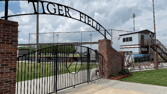 The gates to the Breaux Bridge High School baseball facility, Tiger Field, are locked shut due to school being suspended due to the COVID-19 pandemic. — Photo by Raymond Partsch III