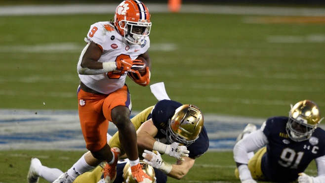 Clemson running back Travis Etienne (9) runs for a touchdown as Notre Dame linebacker Drew White (40) and safety Shaun Crawford (20) and defensive lineman Adetokunbo Ogundeji (91) try to defend during the ACC Championship Game last season. Photo courtesy of Bob Donnan-USA TODAY Sports