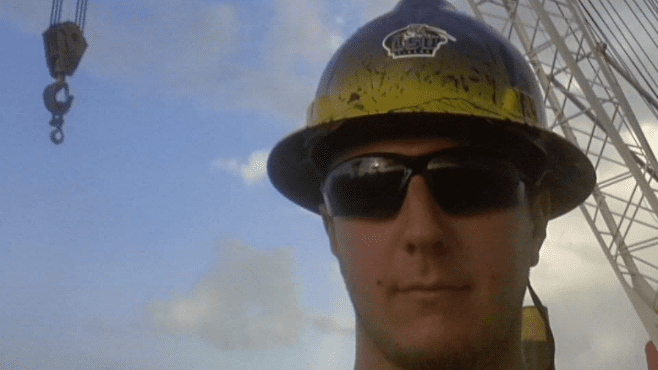 Matthew Bonnette wears his custom LSU hard hat while working as a crane operator. Bonnette lost the hat while working a project in the Mississippi River. — Photo courtesy of Matthew Bonnette