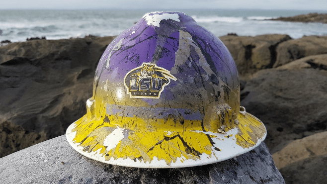 Matthew Bonnette had this custom hard hat,  featuring an LSU logo and team colors, made years ago. Bonnette though lost the hard hat in 2015 while working in the Mississippi River. The hard hat was recently discovered on the shores of Ireland. — Photo courtesy of Burren Shores Beachcombing